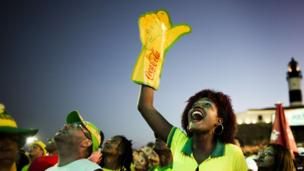 Brazil supporters cheer at FIFA Fan Fest in Salvador on June 23, 2014, during the group A football match between Brazil and Cameron in the 2014 FIFA World Cup