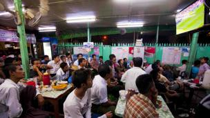 Burmese fans watch Spain's victory over Australia in Rangoon