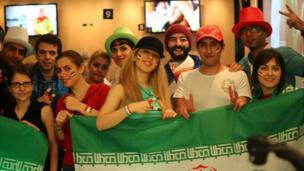 Iran fans in Auckland, New Zealand, gather to watch their side's opening 0-0 draw with Nigeria
