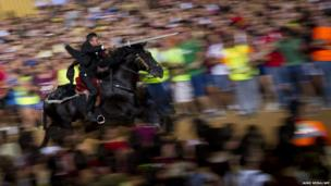 A horseman gallops with a lance during in the traditional San Juan (Saint John) festival