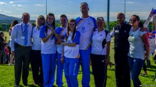 Newbattle High School Baton Bearers pose with the baton with visiting athletes Steve Frew and Susan Egelstaff