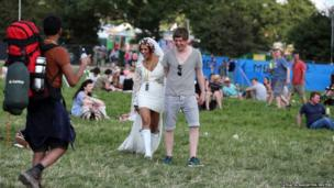 Bianca and Jack Vaughan arrive at Worthy Farm in Somerset for the first day of the Glastonbury Festival after getting married in the local church