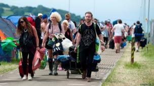 Festival-goers arrive at the venue