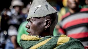 A miner at a rally in Rustenburg, South Africa, 23 June 2014