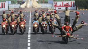 Students perform during a graduation ceremony at the Egyptian Military Academy in Cairo on 24 June 2014
