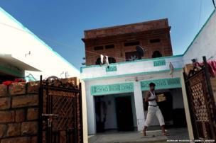 A bishnoi man walk passes the courtyard of his house at Guda Bishnoi village near Jodhpur in Rajasthan, India.