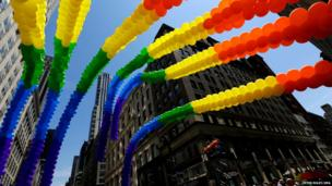 Rainbow coloured balloons float over Fifth Avenue during the 44th annual Gay Pride Parade in New York