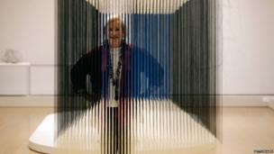 "Patricia Phelps de Cisneros poses with the artwork ""Nylon Cube"" by Venezuelan artist Jesus Soto, part of the exhibition Radical Geometry: Modern Art of South America from the Patricia Phelps de Cisneros Collection at the Royal Academy of Arts (1 July 2014)"