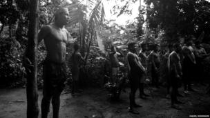 Indigenous residents of Kyikateje-Gaviao gathered in the jungle