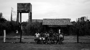 Locals watch a football game in Kyikateje-Gaviao