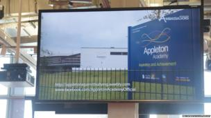 Appleton Academy's video is shown on the big screen