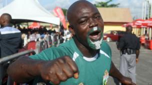A Nigerian football fan in Lagos on 30 June 2014