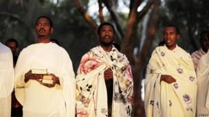African asylum seekers pray in southern Israel's Negev desert, 28 June 2014