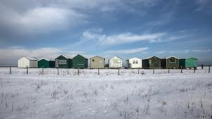 Whitstable beach huts in the snow