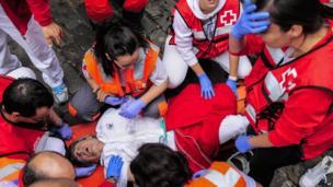 Injured bull runner being treated (7 July 2014)