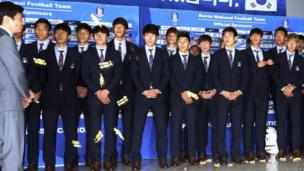 South Korean players are pelted with toffees on their return from Brazil 2014, at Incheon International Airport near Seoul, South Korea, on 30 June 2014