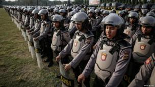 Indonesian police personnel line up during security preparations on 7 July, 2014 in Denpasar, Bali, Indonesia