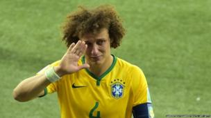 Brazil's defender David Luiz walks off the pitch devastated after his team's shock defeat 1-7 to Germany in the World Cup semi-final