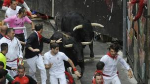 At the world famous San Fermin festival in Pamplona, three runners are hospitalised during the main Running of the Bulls event. Picture was taken on 9 July 2014