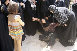 Palestinians mourn during the funeral of members of Kaware family that hospital officials said were killed in an Israeli air strike on their house in Khan Younis in Gaza Strip