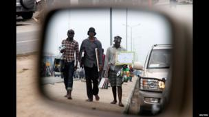 Vendors reflected in the side mirror of a car, Lagos, Nigeria - Saturday 5 July 2014