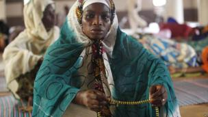 A woman holding prayer beads in a mosque in Lagos, Nigeria - Friday 4 July 2014