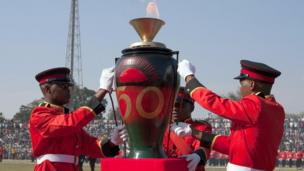 Soldiers holding a pot with a ceremonial flame at official independence celebrations in Lilongwe, Malawi - Sunday 6 July 2014