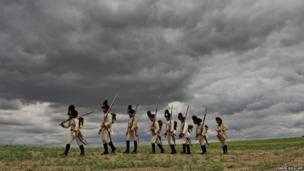 People dressed as soldiers of the Austrian Empire take part in the re-enactment o
