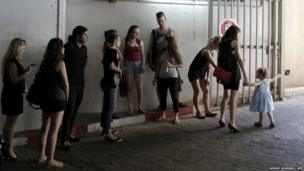 Israelis take cover in an underground car park in the coastal city of Tel Aviv