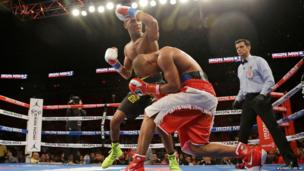 Rances Barthelemy punches Argenis Mendez during a boxing match in Miami