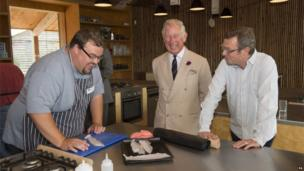 The Prince of Wales with chef and broadcaster Hugh Fearnley-Whittingstall and student Mark Jensen