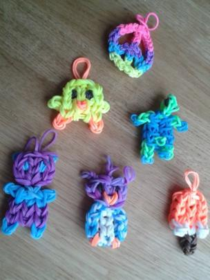 Collection of different loom band models, e.g peace sign, chick, turtle