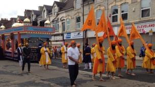 Sikhs parade down the street in Middlesbrough