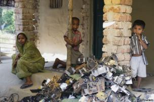 Huge piles of extracted motherboards and PCB'S are dumped inside the courtyard of one of the village house. Life in this village for one and all revolves around several layers of E-Waste.