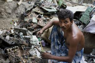 Hakim Naskar, 40, sits amidst a heap of E-waste in his courtyard. With no land to cultivate, this is his only source of income. He works more than fourteen hours every day to maximize his income.
