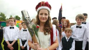Jennifer Pryce, the Corsehill Queen at the Bonnet Guild Gala Day at Lainshaw Primary School, with the Glasgow 2014 Queen's Baton in Stewarton, East Ayrshire.