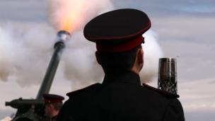 The Queen's Baton arrives at Edinburgh Castle for a 21 gun salute.