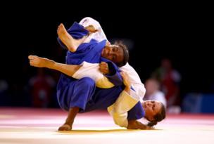 Scotland's Kimberley Renicks beats Cameroon's Marcelle Monabang in the Women's 48kg Judo quarter finals