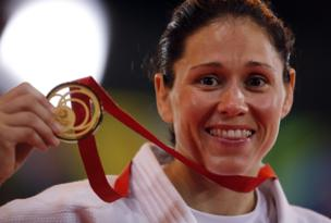 Louise Renicks shows her gold medal after winning the -52kg Judo final
