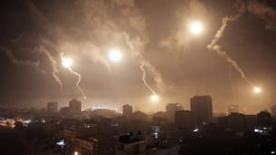 Israeli forces' flares light up the night sky of Gaza City early 29 July 2014.