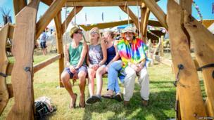 Festival-goers on a swing