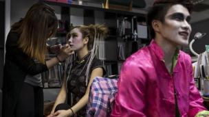 "A model has is made up to look like a Chinese ghost before a ""Funeral Fashion Show"" during the Chinese Hungry Ghost Festival in Hong Kong on 10 August, 2014"