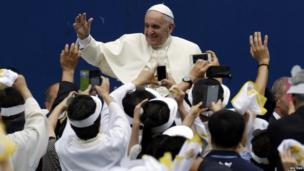 Pope Francis is greeted upon his arrival for the Mass at Daejeon World Cup stadium in Daejeon on 15 August, 2014