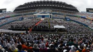 Thousands of followers attend a mass conducted by Pope Francis at Daejeon World Cup Stadium on 15 August, 2014