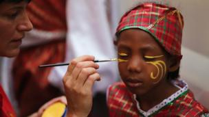 Girl getting her face painted for the carnival.