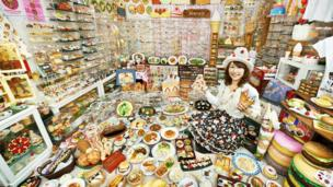 Woman displays her plastic food collection