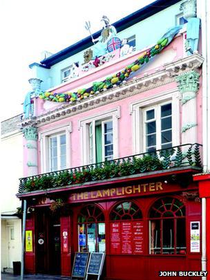Lamplighter in St Helier