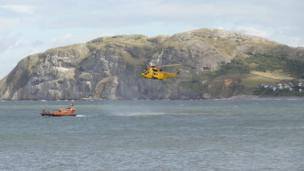 Llandudno RNLI lifeboat and the RAF Valley rescue helicopter