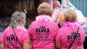 Three women with Elvis T-shirts
