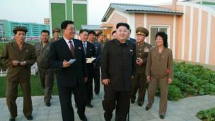 Kim Jong-un with advisors